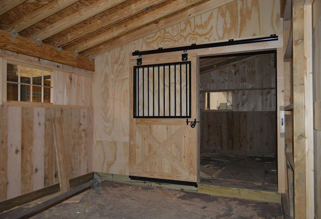 Custom horse barn new hope pa j n structures for Horse stall door plans