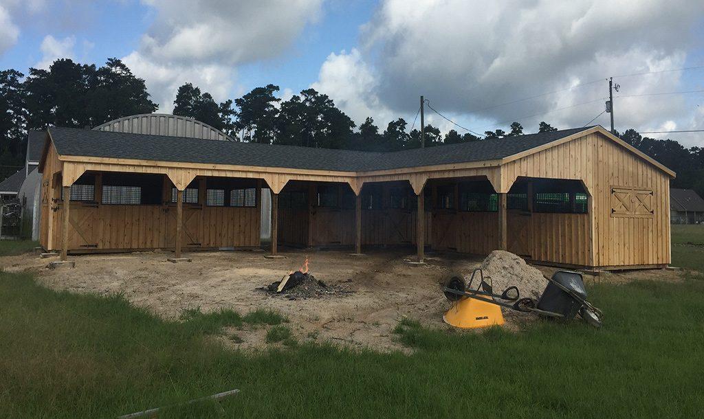 Custom l shaped barn zachary la j n structures for Barn shaped garage