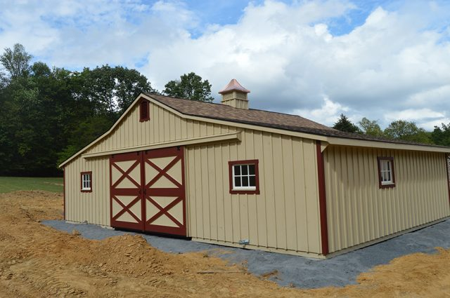 Tan paint red trim trailside barn