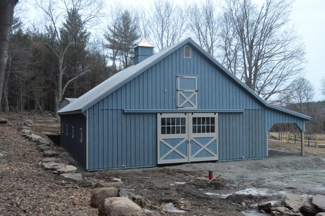 Completed Blue Modular Barn with Lean To in Granbury, MA