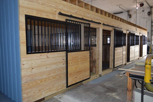 Modular horse stalls being manufactured in MA