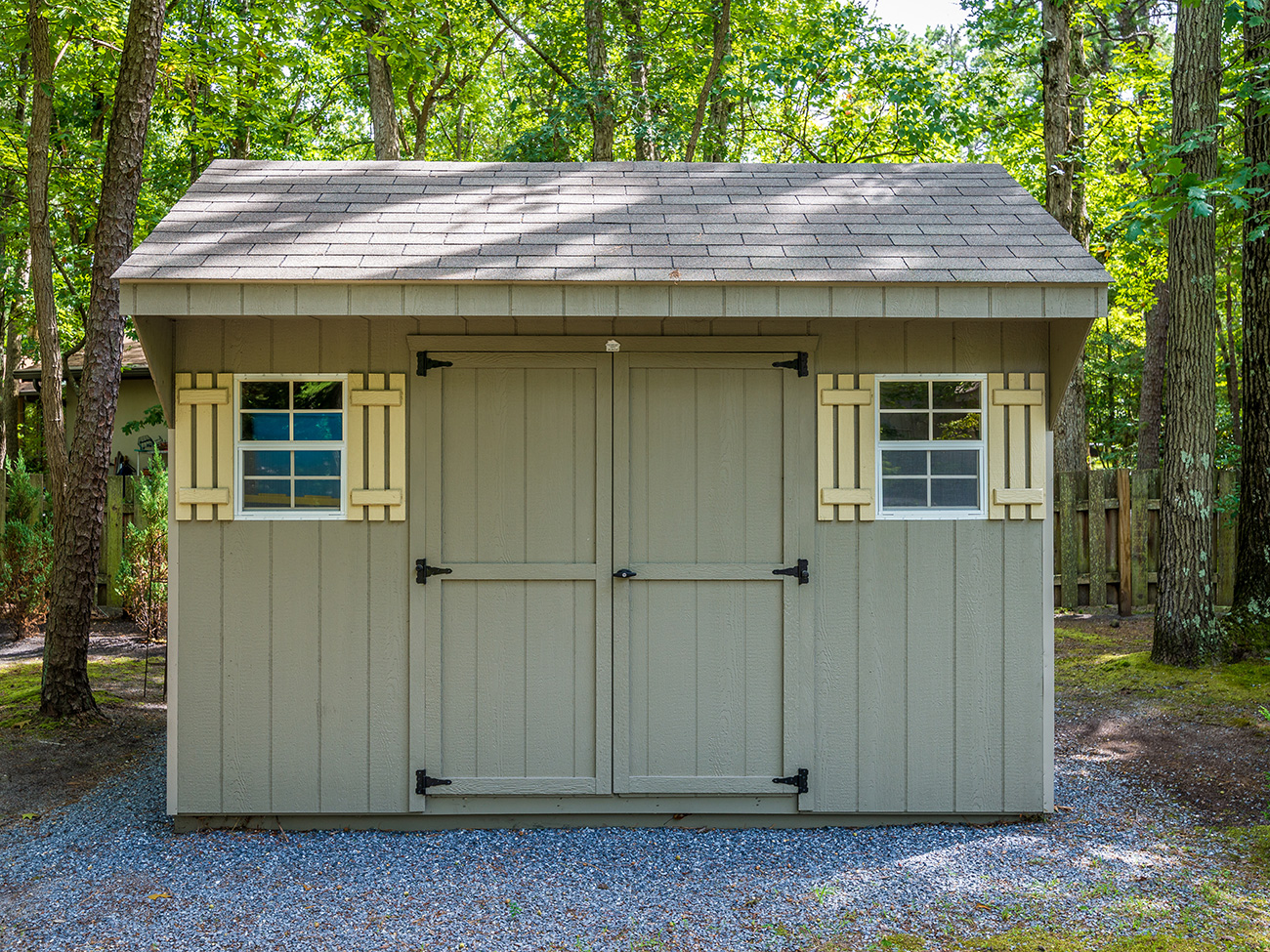 Green Backyard Storage Shed with Shutters