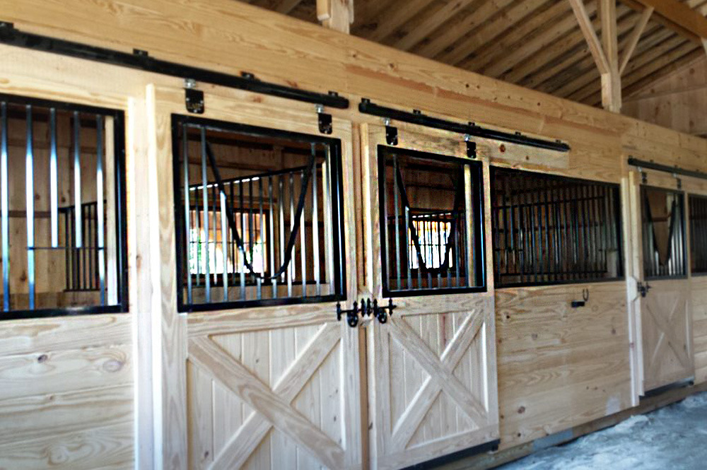 Interior horse stalls of trailside barn