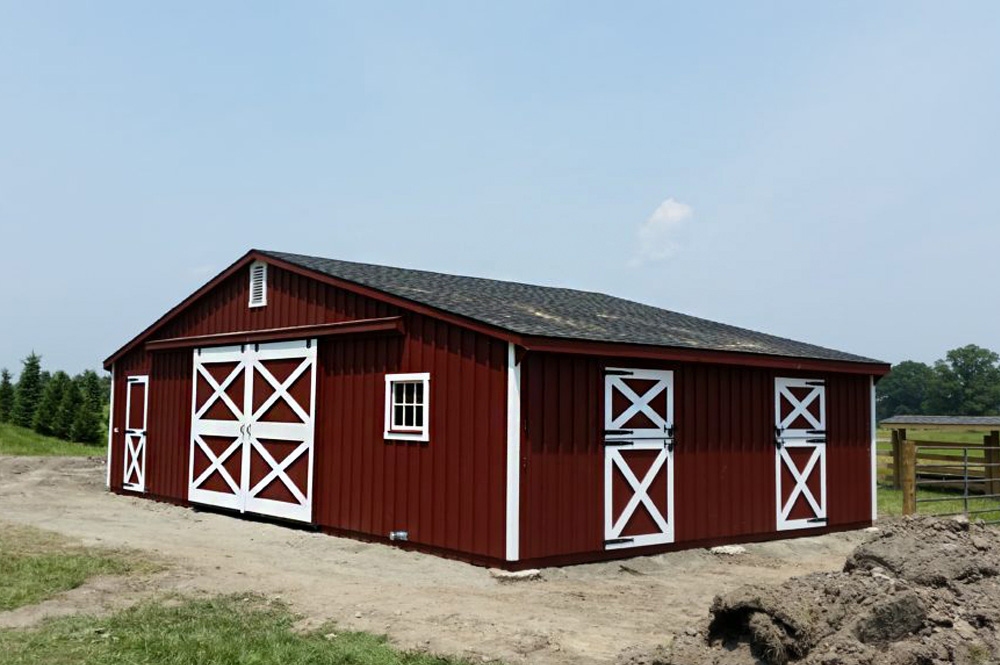 Red trailside barn with white trim