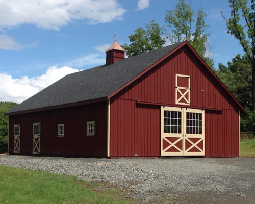 Virginia horse barn with tan trim