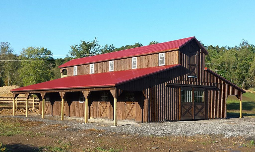 Monitor style barn with red metal roof