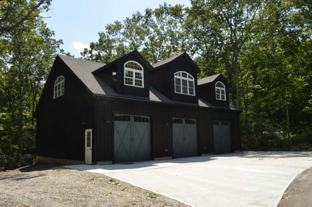 black board and batten three car door garage with loft in Woodbury, Connecticut