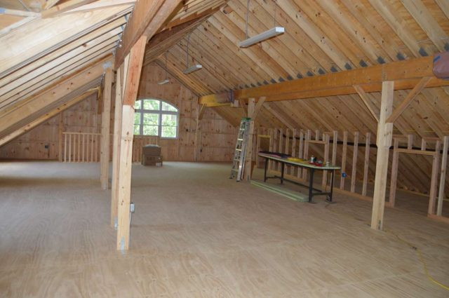 custom garage with loft made of white pine board in Woodbury, CT