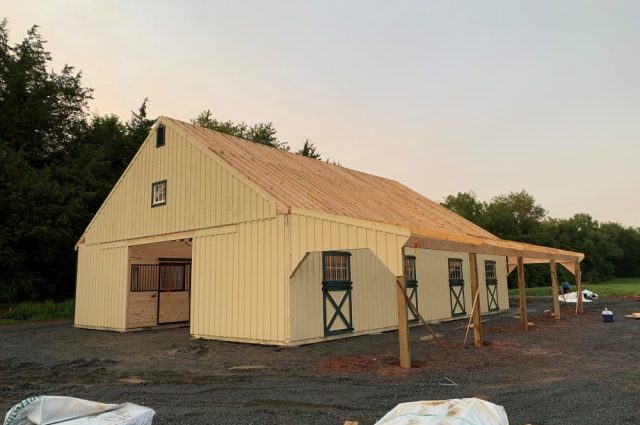 white pine board and batten siding painted horse barn in Scottsville, VA