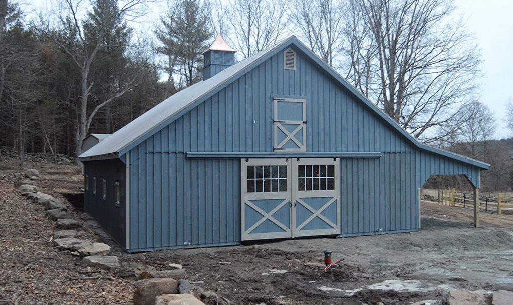 Horse barn garage with blue siding