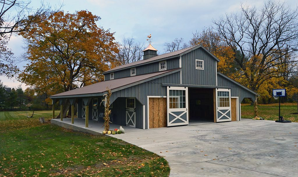 Horse barn garage with blue siding and white trim