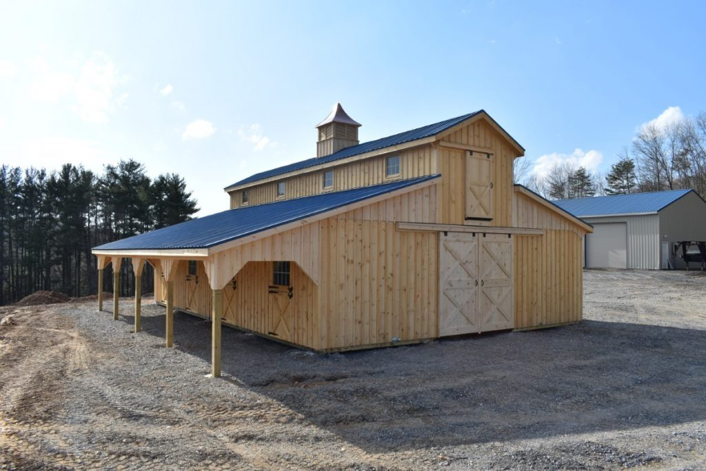 Two story horse barn with wooden siding