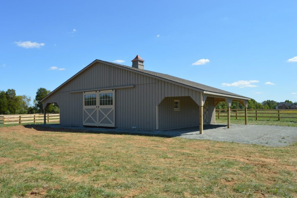 Gray horse barn with neutral trim