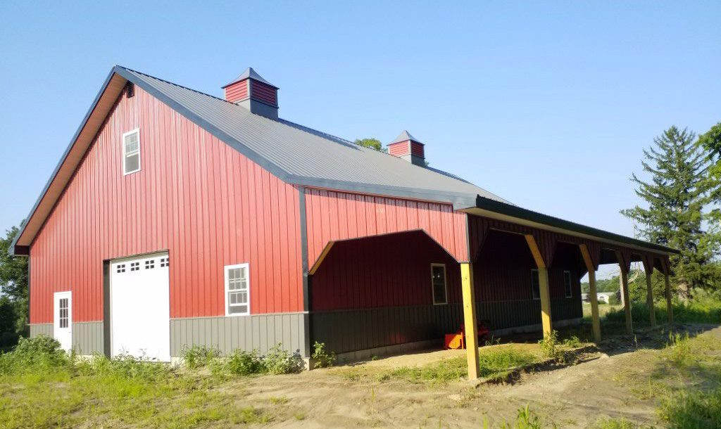 Large red horse barn garage with storage