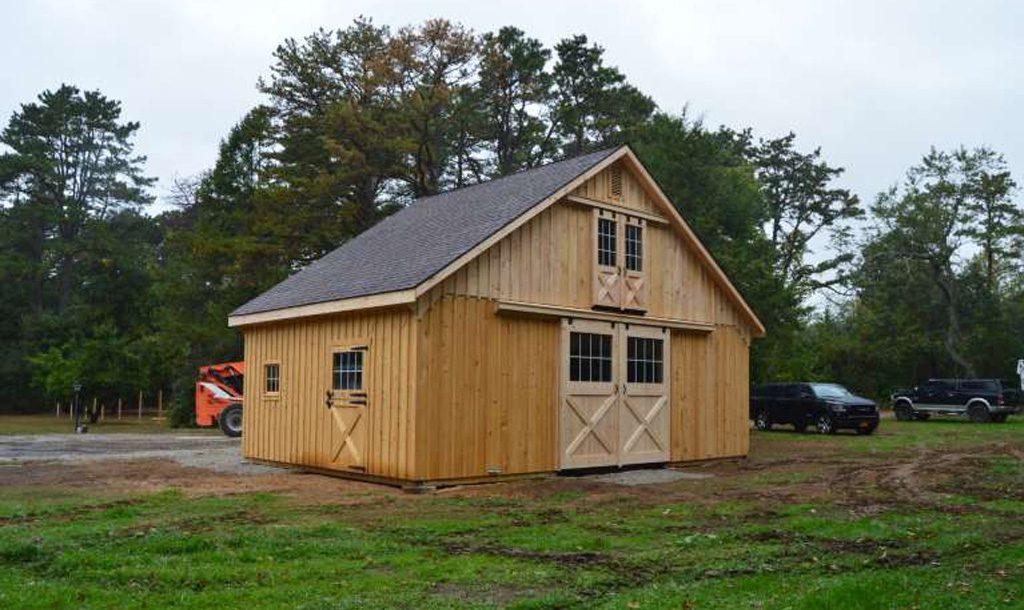 Horse barn with wood siding and loft