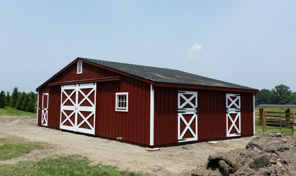 One story horse barn with red and white color scheme