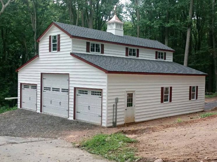 Barn style garage with red trim