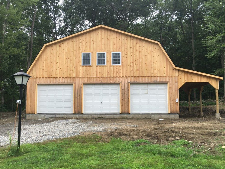 Unstained wood garage barn style
