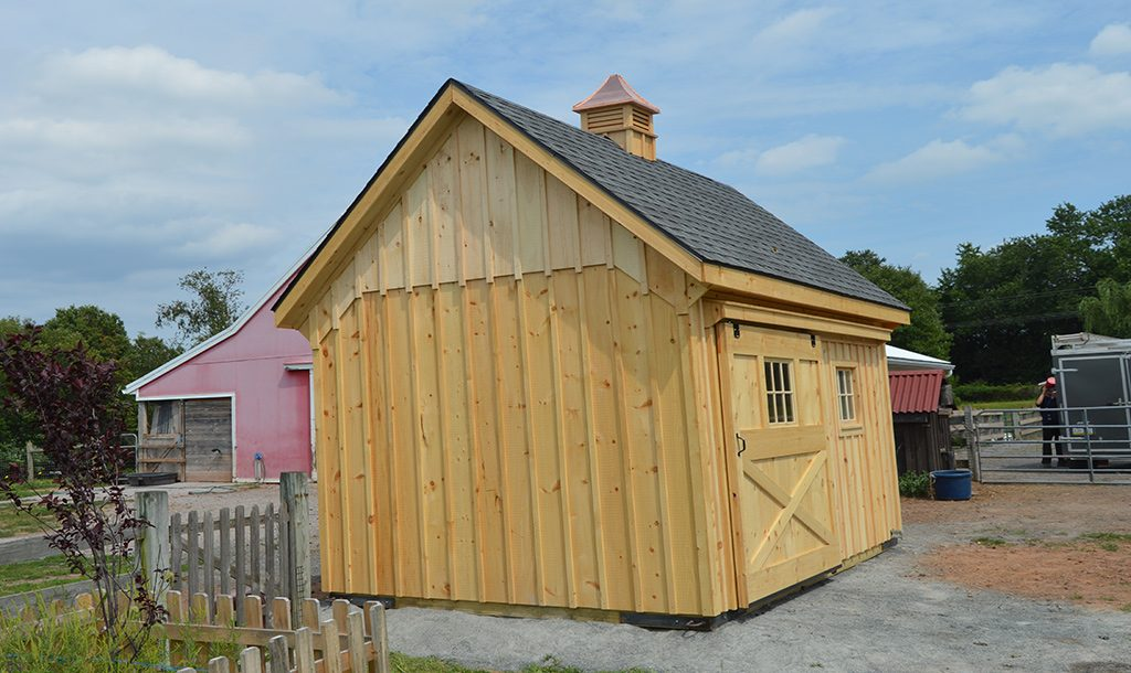Small horse barn designed with cupola