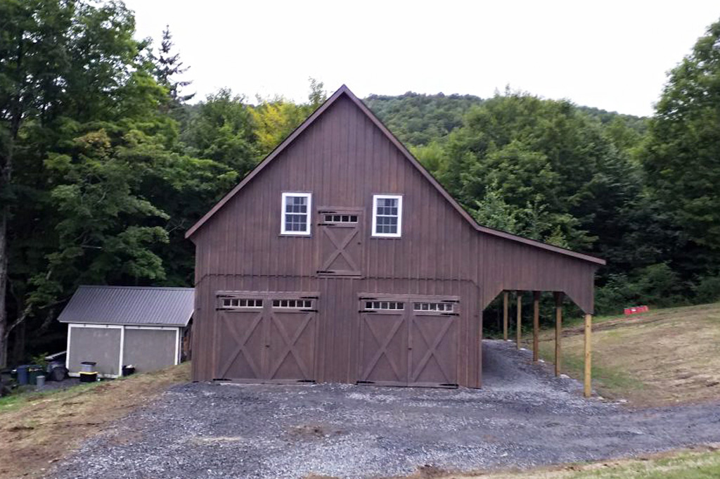 Two store garage style with A-frame roof