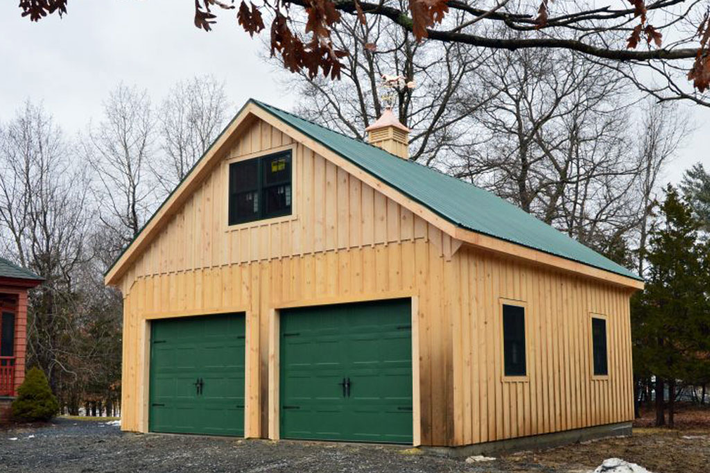 Natural garage exterior color with green roof