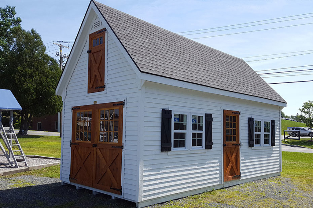 Rustic farmhouse garage with white siding