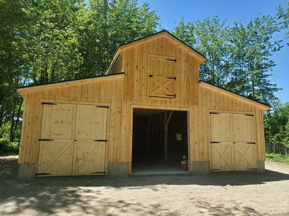 Two story horse barn with open doors
