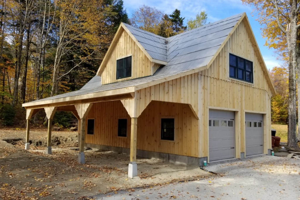 two-story garage with overhang