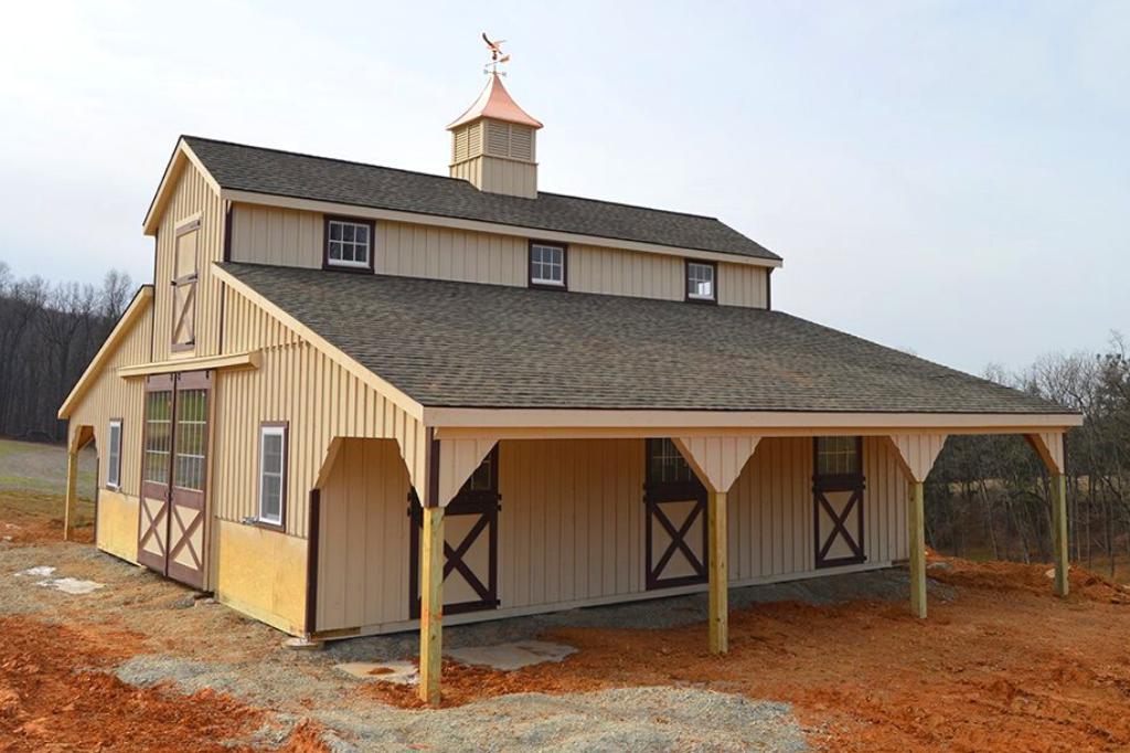 Light caramel barn color with maroon trim
