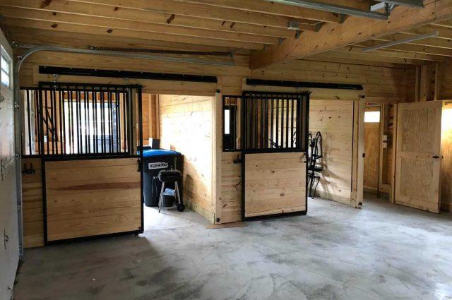 garage with horse stalls