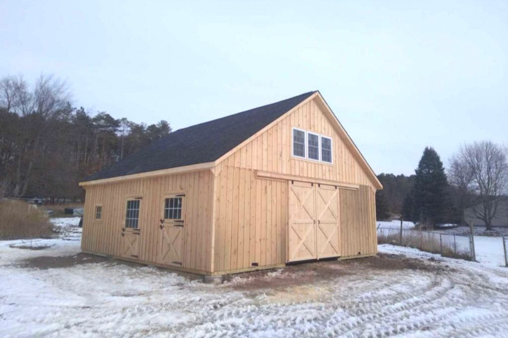 5 stall horse barn with naturally stained wood exterior
