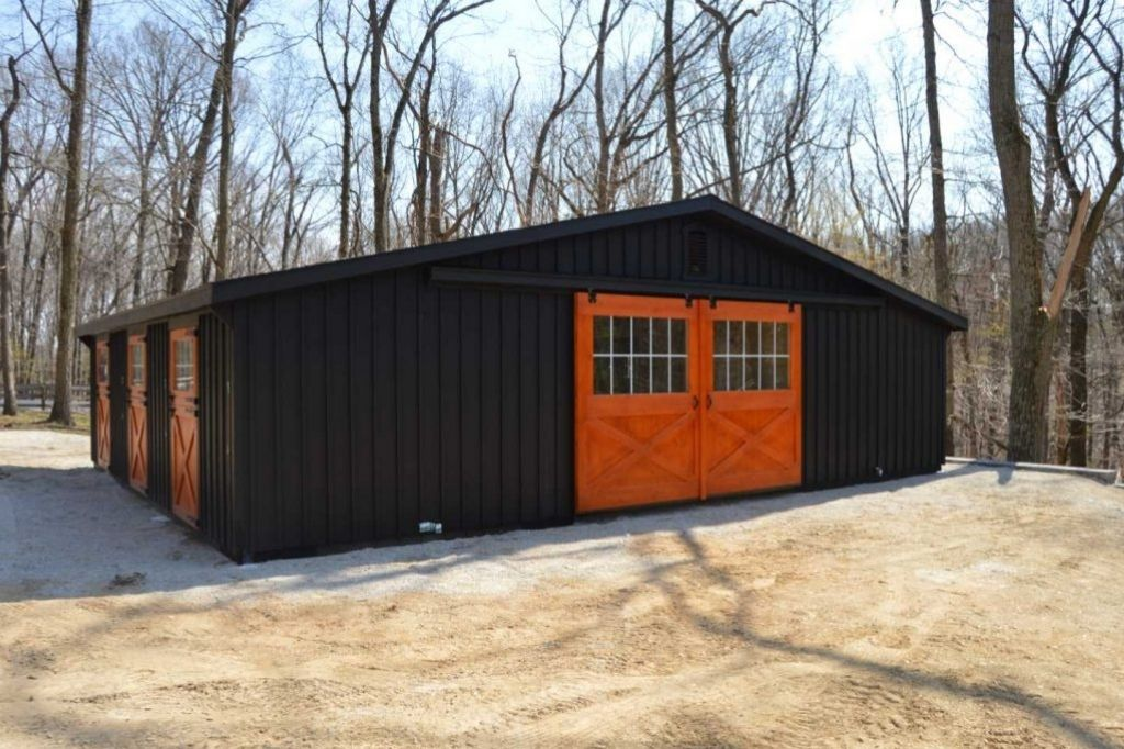 5 Stall horse barn with black and orange exterior