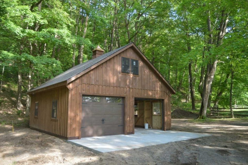 New brown free standing garage in forest