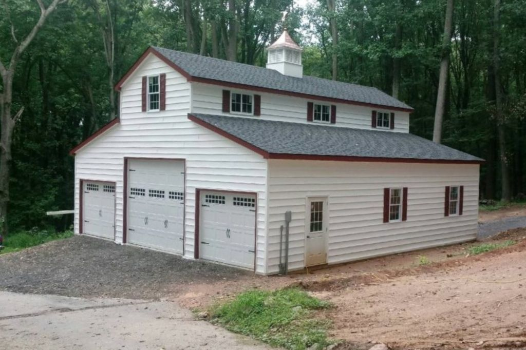 White and red 3-car garage with loft